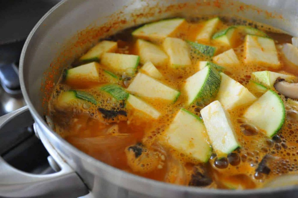 boiling stew in pot with vegetables