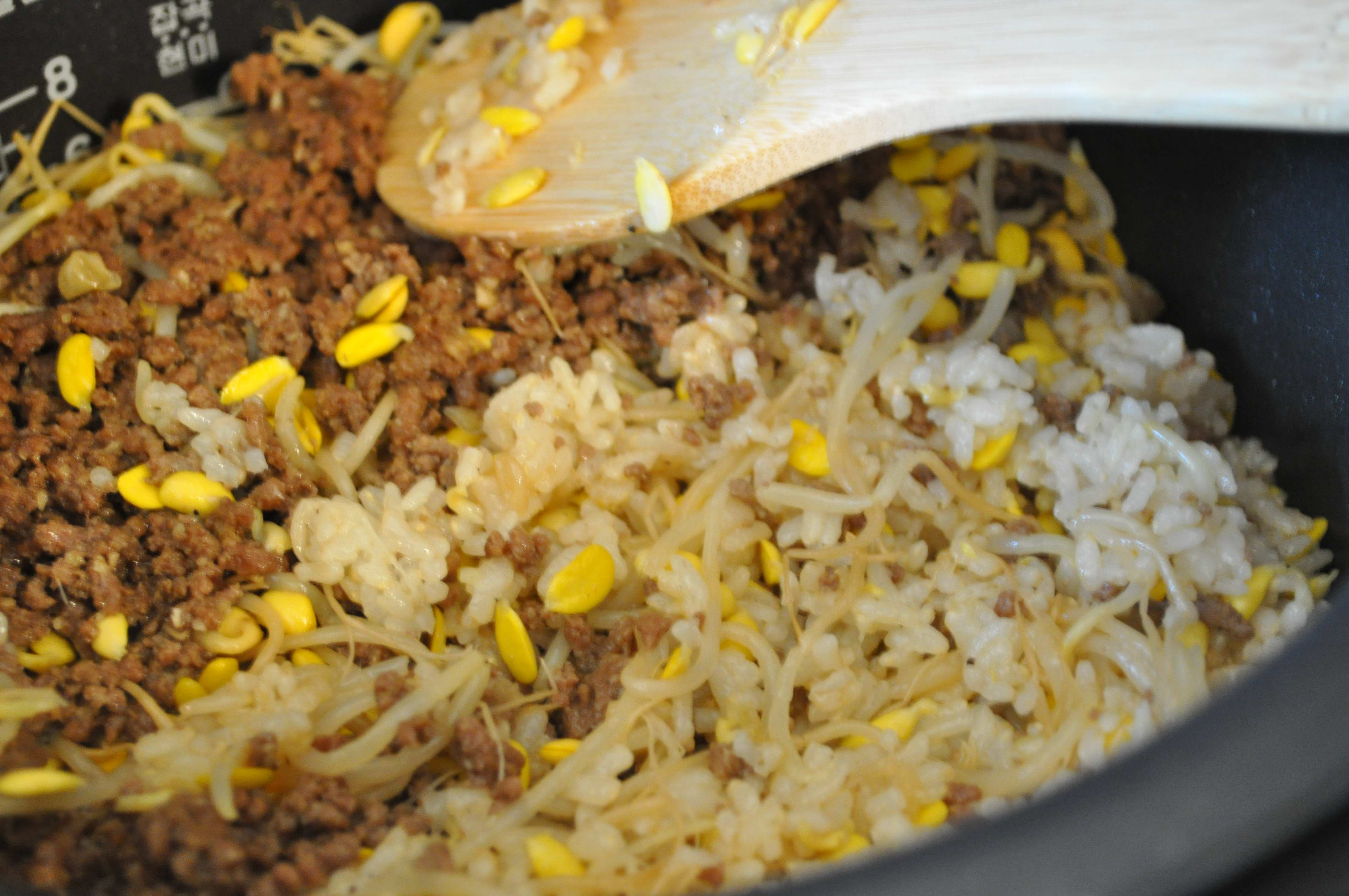 mixing the cooked rice