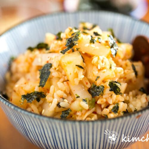 kimchi mari rice in bowl with wooden spoon