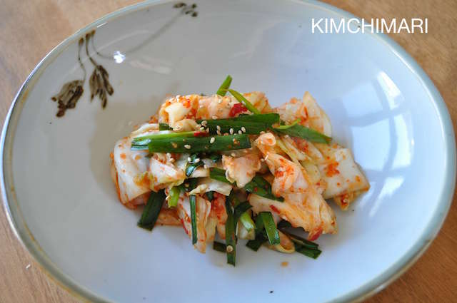 Finished green cabbage kimchi in bowl