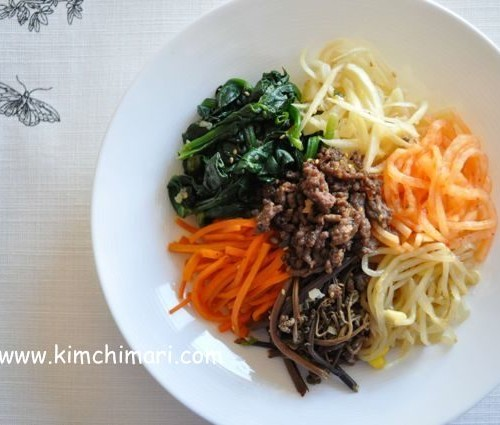 bibimbap plated with wild greens without egg
