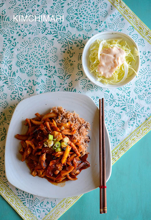 spicy squid stir fry with cabbage salad