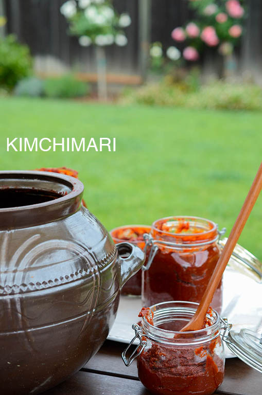 Filling glass canning jars with Gochujang in my patio