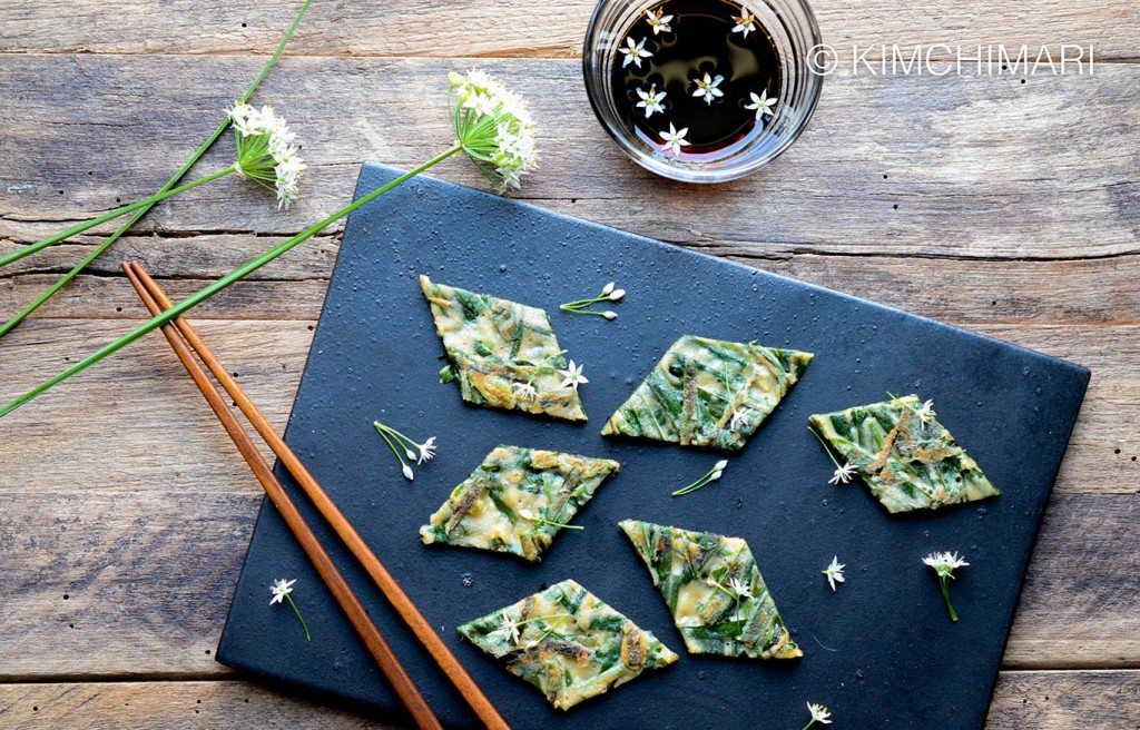 Buchujeon or Korean Chive Pancakes cut into diamond shapes with Chive flowers