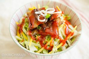 Miso Pork Belly rice bowl with cabbage, carrots, green onions and gochujang sauce