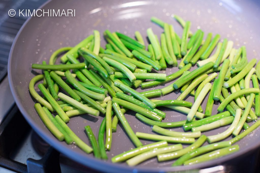 Garlic Scape sauteeing in pan