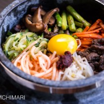 Bibimbap in Stone Pot with vegetable and meat toppings and egg yolk