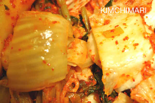 side by side pic of sour kimchi and fresh kimchi