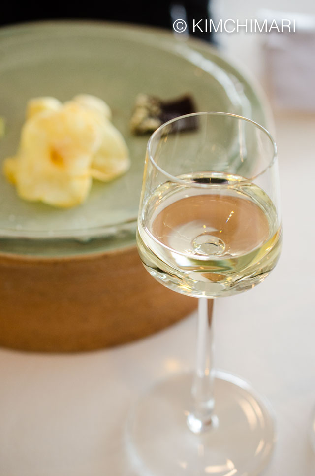 Dandelion Rice Wine in small wine glass on table