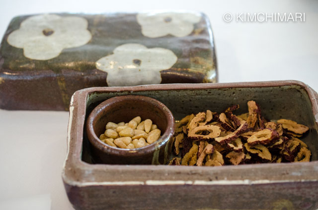 Ceramic box filled with dried jujubes and pine nuts