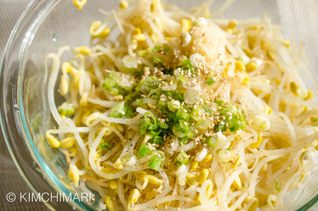 Green onions, garlic and seasoning added on top of Cooked Soybean Sprouts