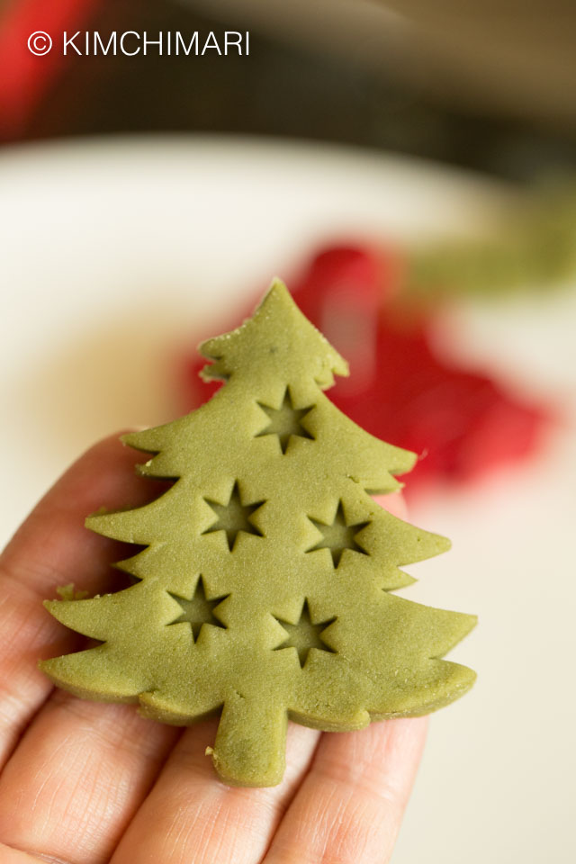 Green Tea cookie cut out into Christmas tree shape using Piecrust cutter
