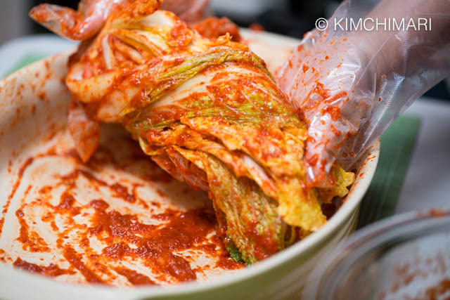 Cabbage coated with Kimchi seasoning wrapped with outermost leaf