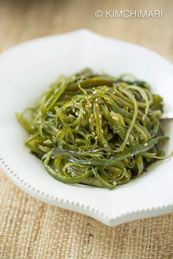 Korean Seaweed Side Dish in white plate on straw placemat