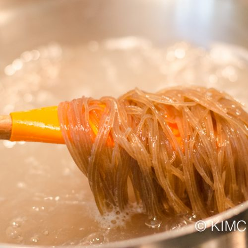 noodles cooking in boiling water