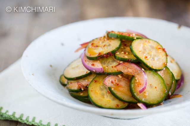 cucumbers salad plated on white dish