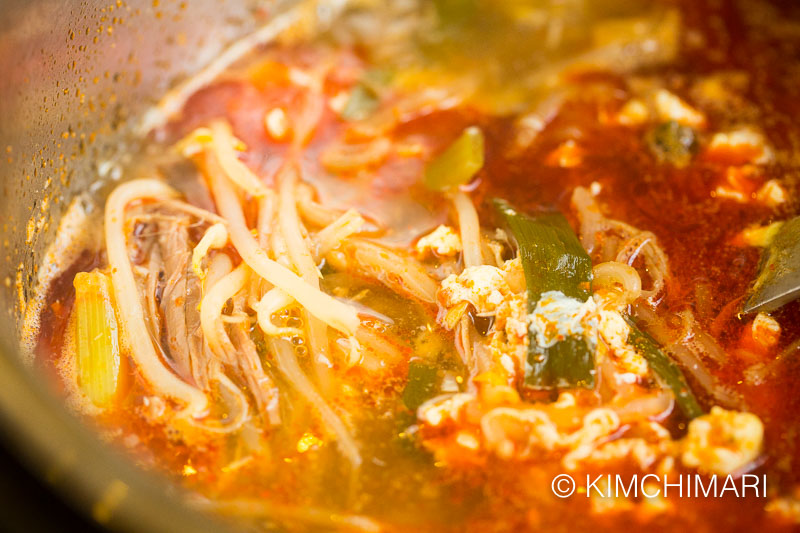 spicy beef soup with egg added
