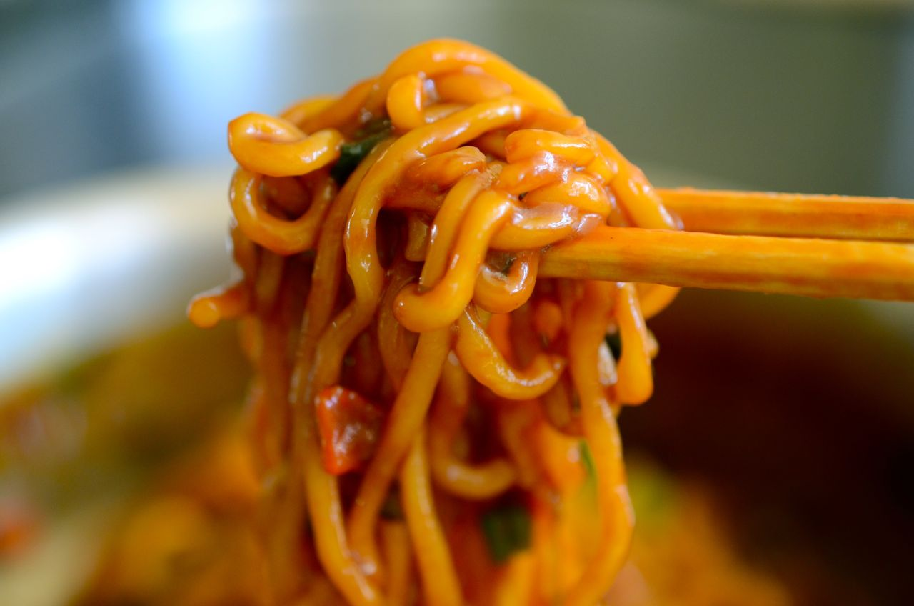 jjapaguri noodles lifted with chopsticks