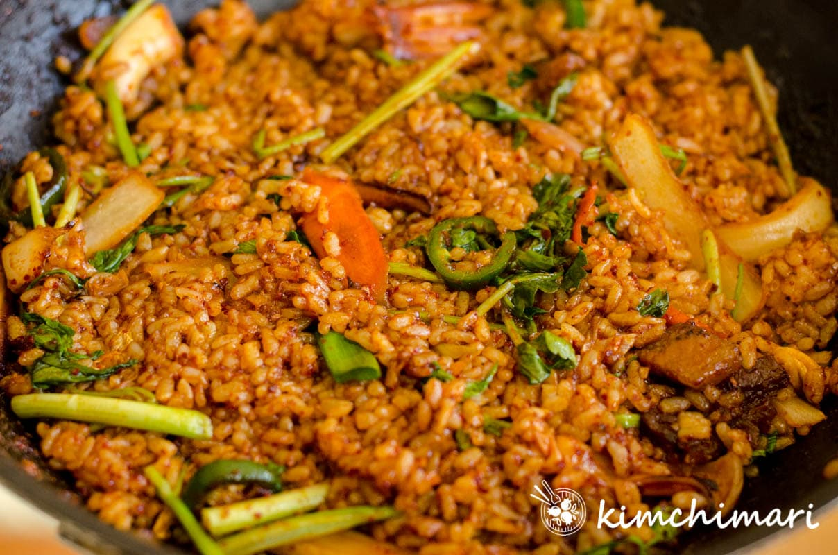 fried rice in pan with minari added