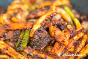 osam bulgogi spicy squid and pork stir fry all cooked in pan looking spicy and glistening