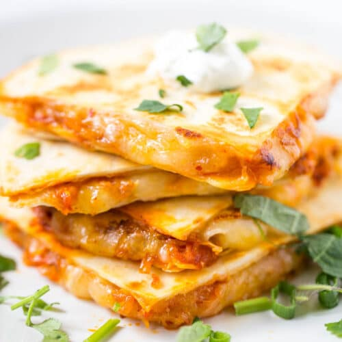 Kimchi Quesadilla sliced and stacked on white plate