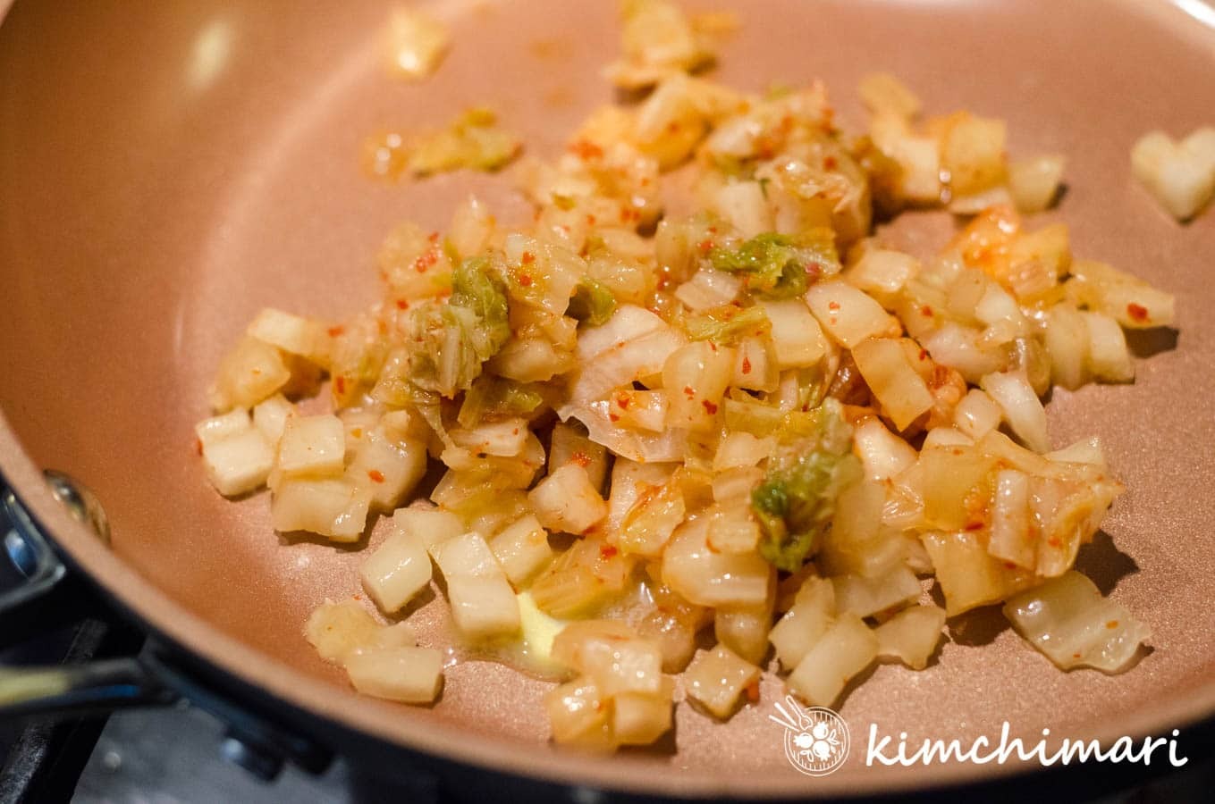 chopped kimchi and butter in pan ready to saute