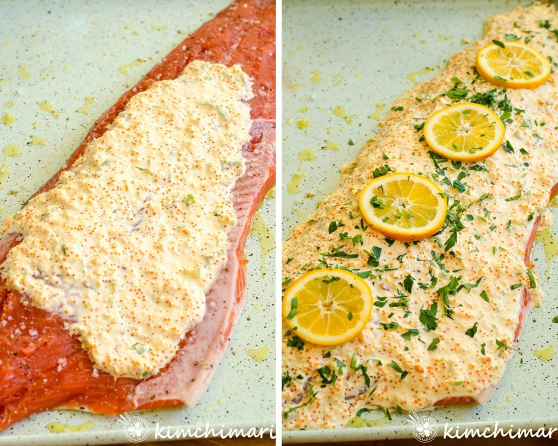 whole salmon fillet covered in mayo masago sauce and lemon slices