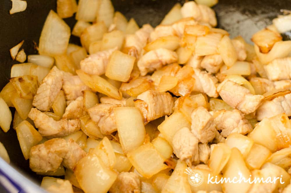 pork and onions fully sauteed in pan