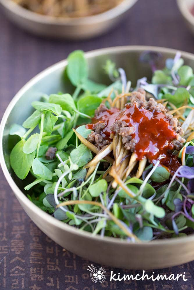 sprouts or microgreens bibimbap served in traditional korean brass bowl