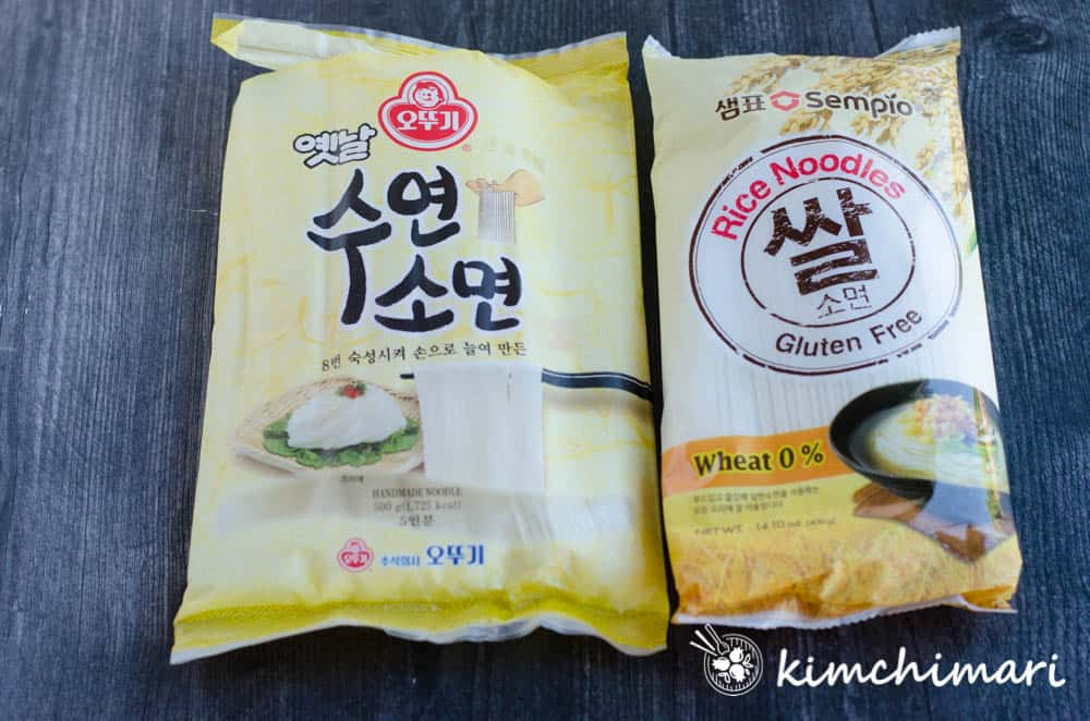 side by side packages of ottogi wheat somyeon and sempio gluten free rice somyeon