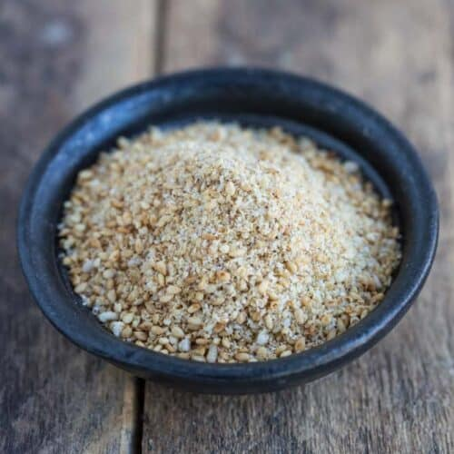 ground sesame seeds and salt in small black bowl