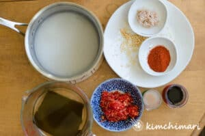 top view of different kimchi seasoning ingredients in bowls