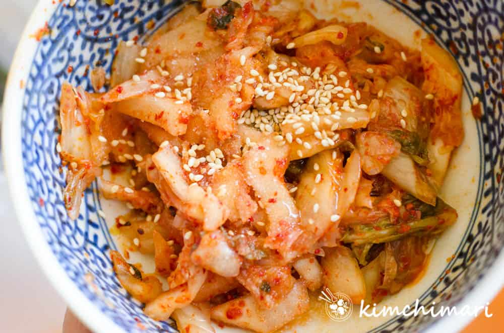 seasoning cut kimchi for topping on Cold Kimchi Noodle soup